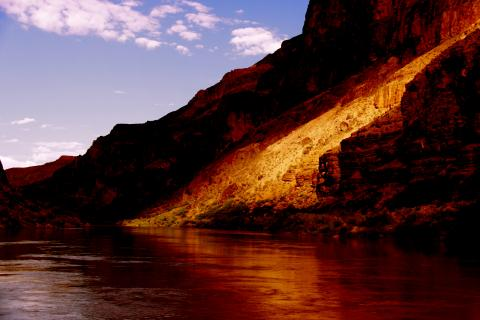 Light strikes the Grand Canyon walls and Colorado River