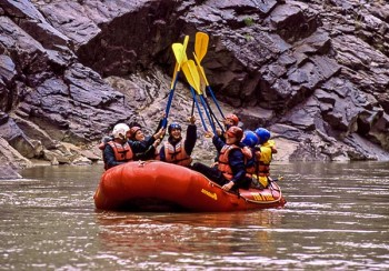 westwater-canyon-rafting-paddle-high-five